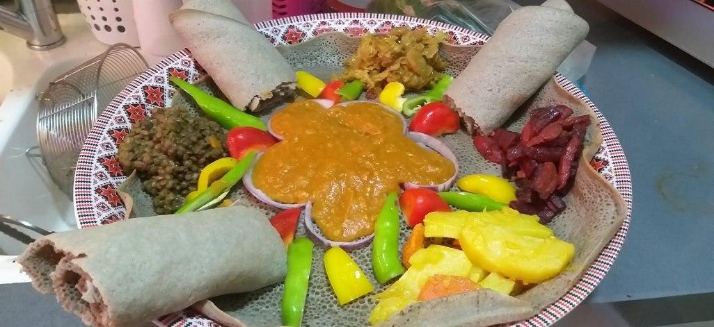 תמונת רקע מגננ'ה מסעדה אתיופית